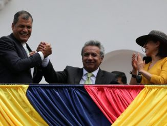 Ecuador's President Rafael Correa (L) greets Presidential candidate Lenin Moreno (C) next to his wife Rocio Gonzalez as they stand on the government palace's balcony during a military change of guard ceremony in Quito, Ecuador April 3, 2017. REUTERS/Mariana Bazo